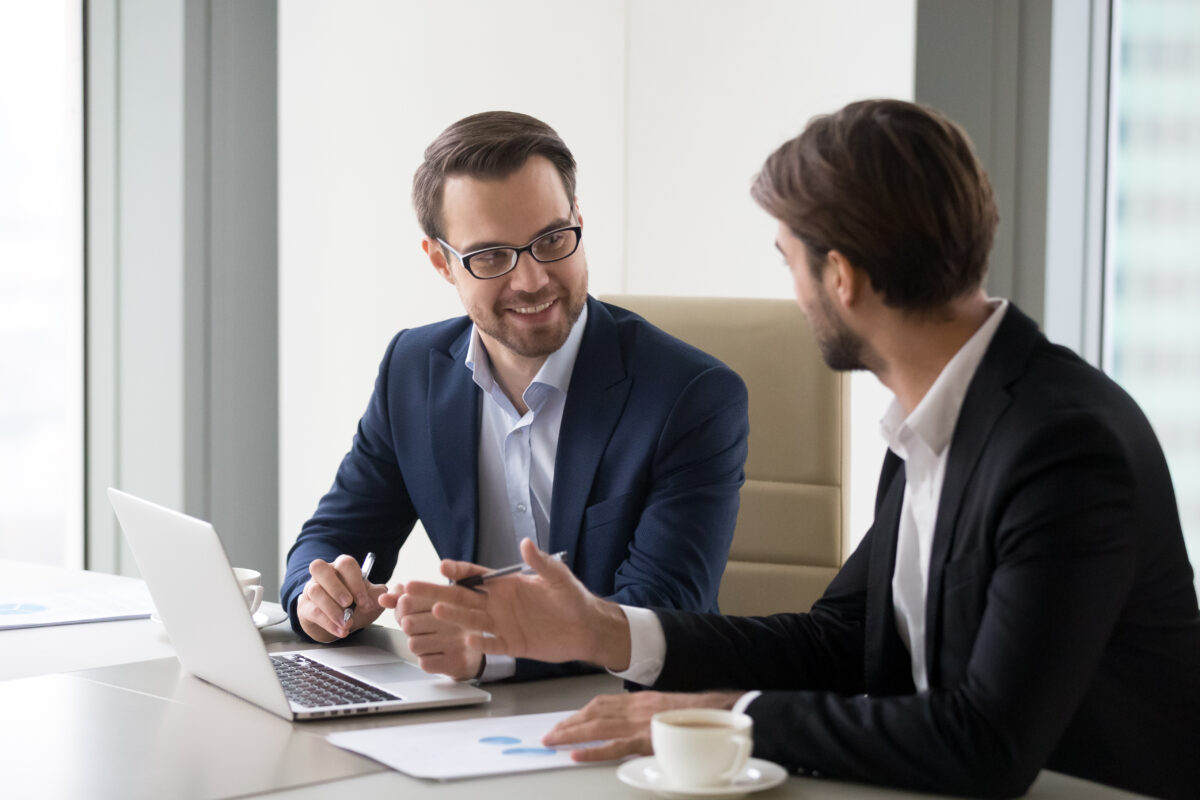 two businesspeople having